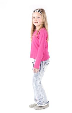 headband: Cute little girl standing in studio