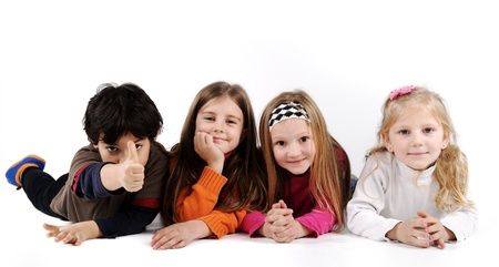 four friends: Children group family laying on ground floor isolated Stock Photo