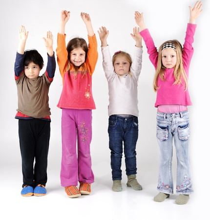 Four children group with arms up photo