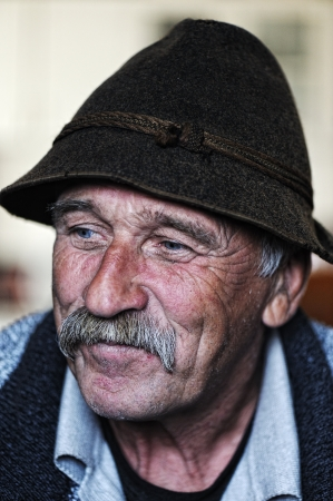 Portrait of old man with mustache photo