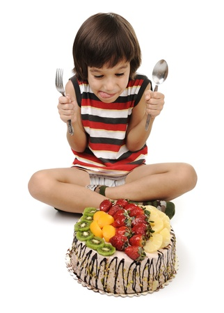 Kid eating cake photo