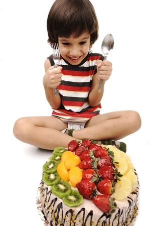 Kid eating fruit cake Stock Photo