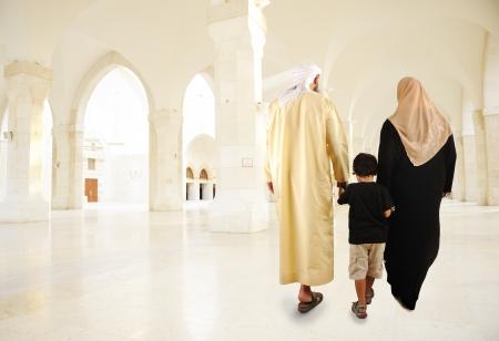 Arabic Muslim family walking indoor photo