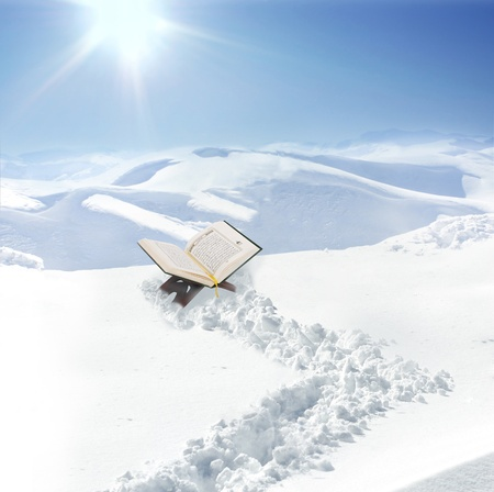 holy book: Koran at snow in mountain, concept