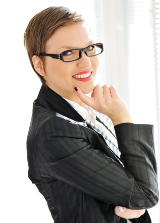 Beautiful business woman with short hair and glasses Stock Photo - 13665161