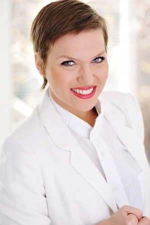 Portrait of positive young business woman smiling Stock Photo - 13665139