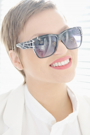 Female beauty, young woman with glasses and short hair photo