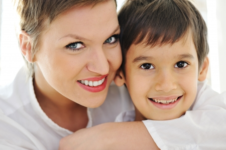 Happy mother hugging her son Stock Photo - 13665230