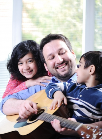 Happy family playing guitar together Stock Photo - 13665145