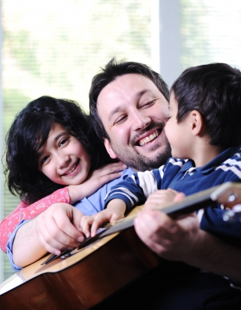 Father and his children having good time at home Stock Photo - 13665096