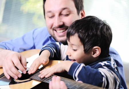 Father and son playing guitar at home Stock Photo - 13665137