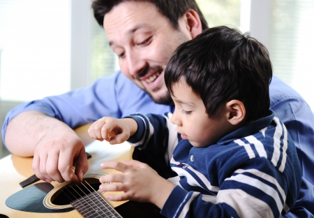 Father and son playing guitar at home Stock Photo - 13665167