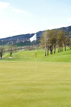 Flag on golf field photo