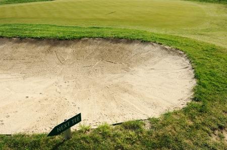 Next tee sign arrow direction golf field photo