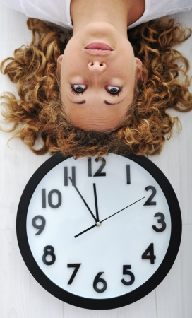 Girl and clock upside down photo