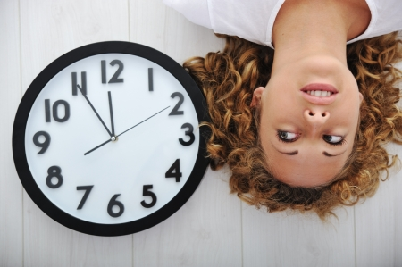 Blonde girl and clock Stock Photo - 13667792