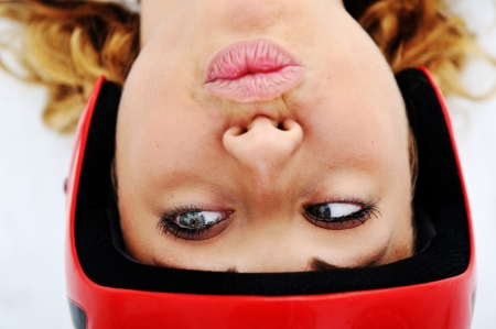 Funny girl with red helmet and silly expression photo
