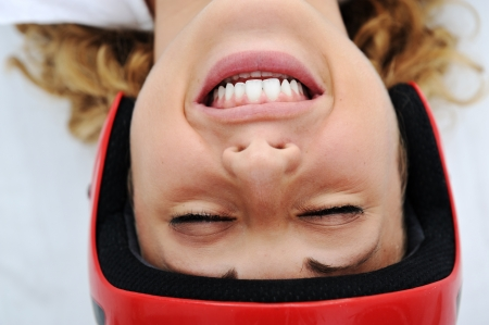 Funny girl with red helmet smiling photo