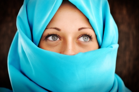 middle eastern clothes: Young woman with blue scarf Stock Photo