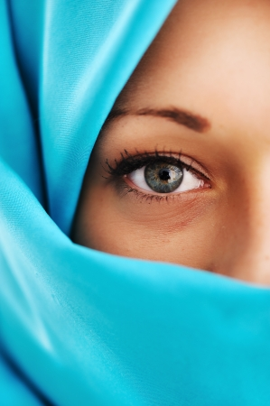 veil: Young woman with blue scarf Stock Photo
