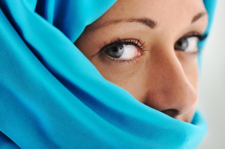 middle eastern woman: Young beautiful muslim woman in blue scarf Stock Photo