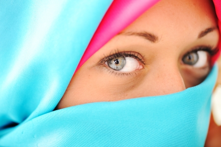 Young beautiful muslim woman in blue scarf photo