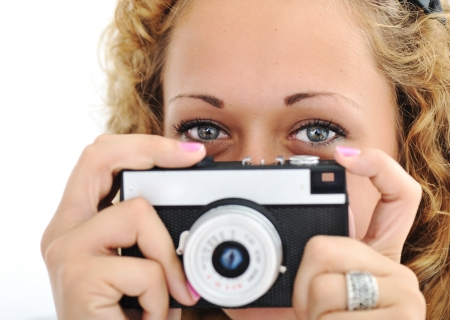 Cute girl with camera isolated Stock Photo - 13667745