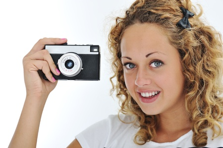 Cute girl with camera isolated Stock Photo - 13667840