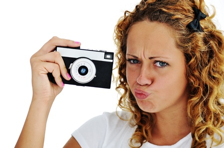 Cute girl with camera isolated photo