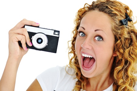 An excited teenage girl shouting holding a retro camera in hand  photo