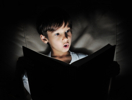 one story: Kid reading book, light in darkness
