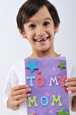 Kid holding message for lovely Mom photo