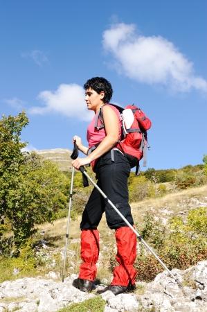 Nordic Walking in Autumn mountains, hiking woman photo
