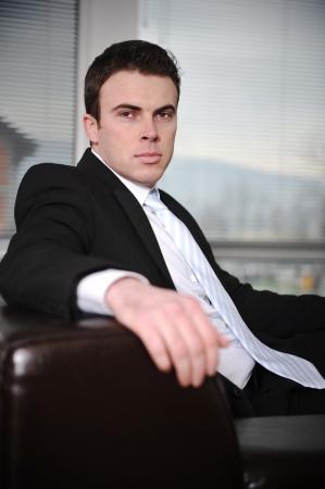 Businessman sitting on sofa in modern office Stock Photo - 13667685