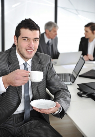 Businessman in business ambience drinking cofee Stock Photo - 13667760