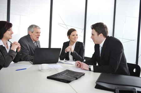 Group of business people having a discussion in office photo