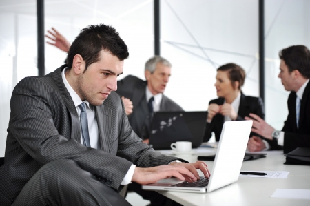 Businessman in business ambience working on laptop Stock Photo - 13667727