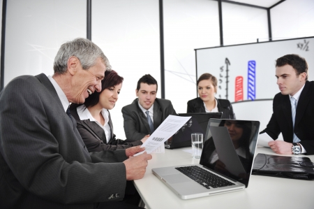 Boss reading report at business meeting Stock Photo - 13667709