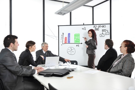 reunion: Businesswoman drawing a diagram during the presentation at office Stock Photo