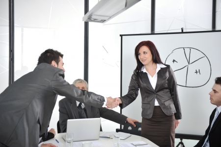 Hands shaking and making deal at office meeting photo
