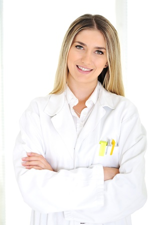 Young blonde doctor working at hospital photo