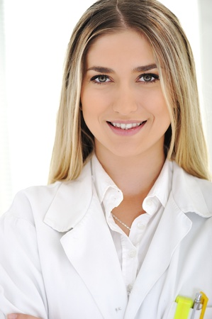 serious doctor: Young blonde doctor working at hospital Stock Photo