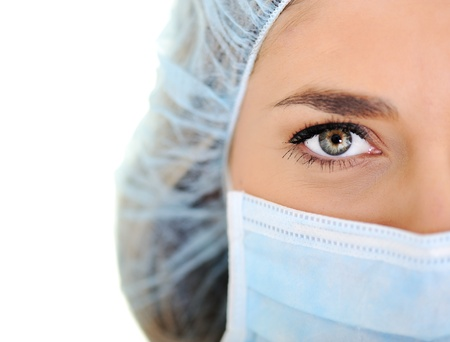 Female doctor wearing surgical cap and mask Stock Photo