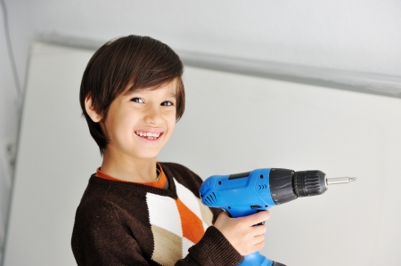 Kid with drill tool photo