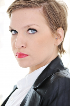 Beautiful young business woman with short hair photo