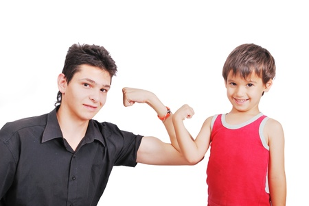 Young teenager and young boy showing off photo