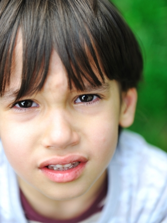 sad boy: an a beautiful kid is crying