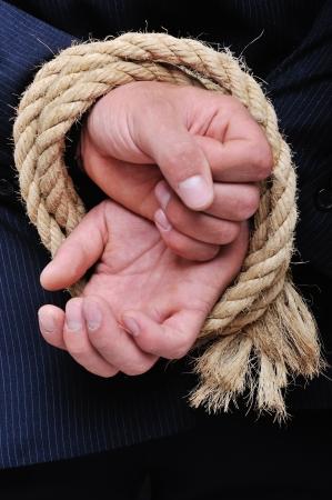 stuck up: Rope binding mans hands