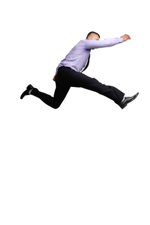 Jumping businessman isolated on white background photo