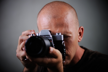 Closeup of a photographer with camera Stock Photo - 13826847